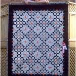 Ariana and Luis and their cathedral window quilt